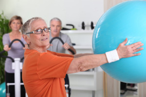 Senior woman lifting fitness balloon