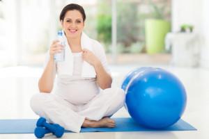 Meta Slider - HTML Overlay - pregnant woman holding bottle of water