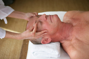 senior man having a massage in a spa center