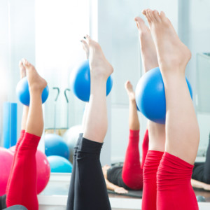 Aerobics pilates women feet  with yoga balls