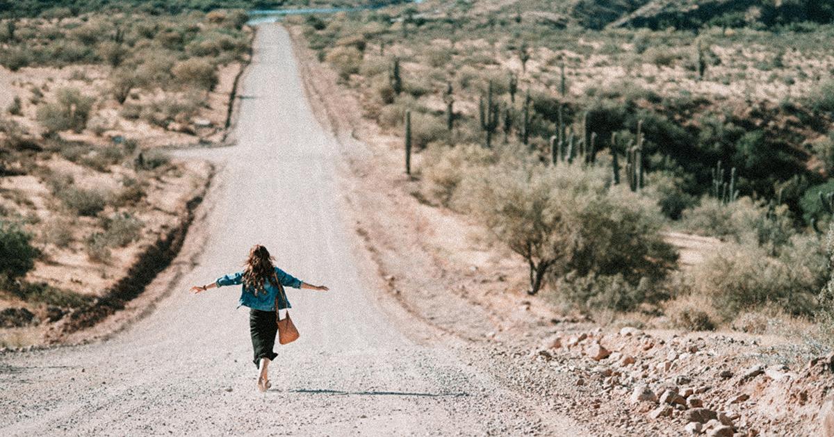 woman-walking-dirt-road