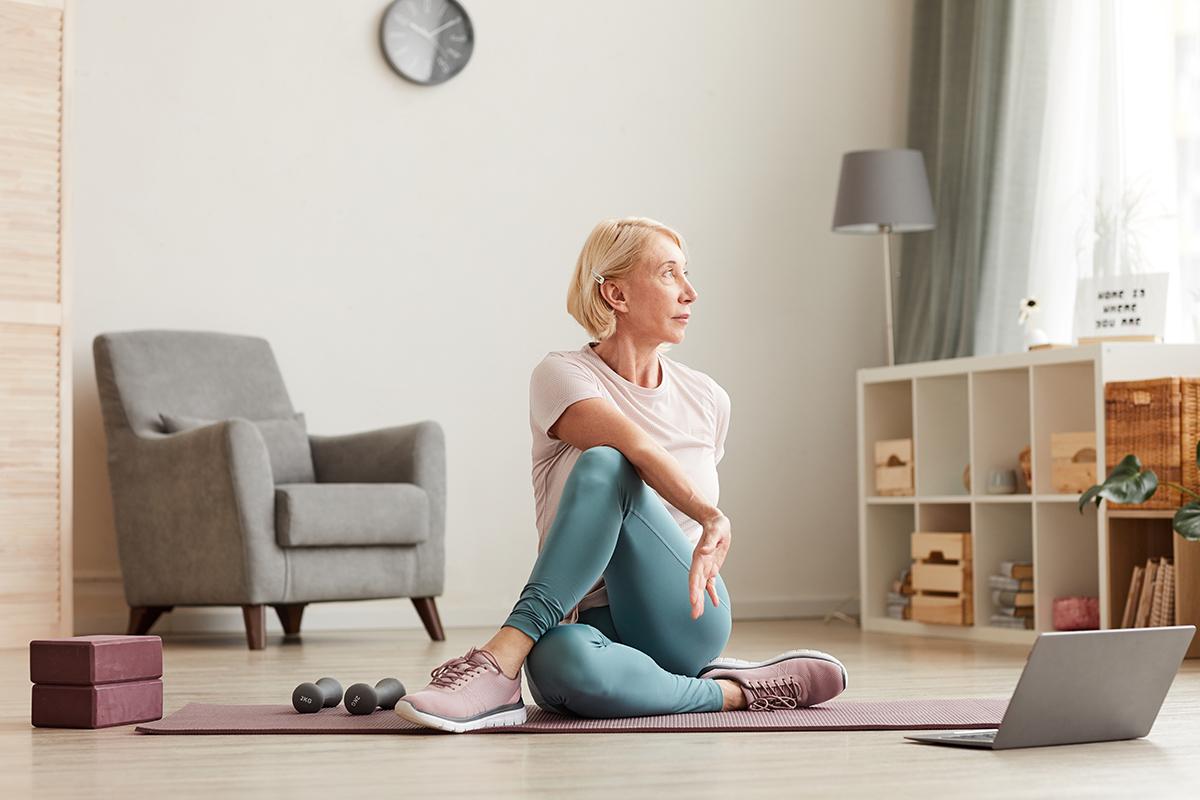 mature-senior-woman-home-exercise-yoga
