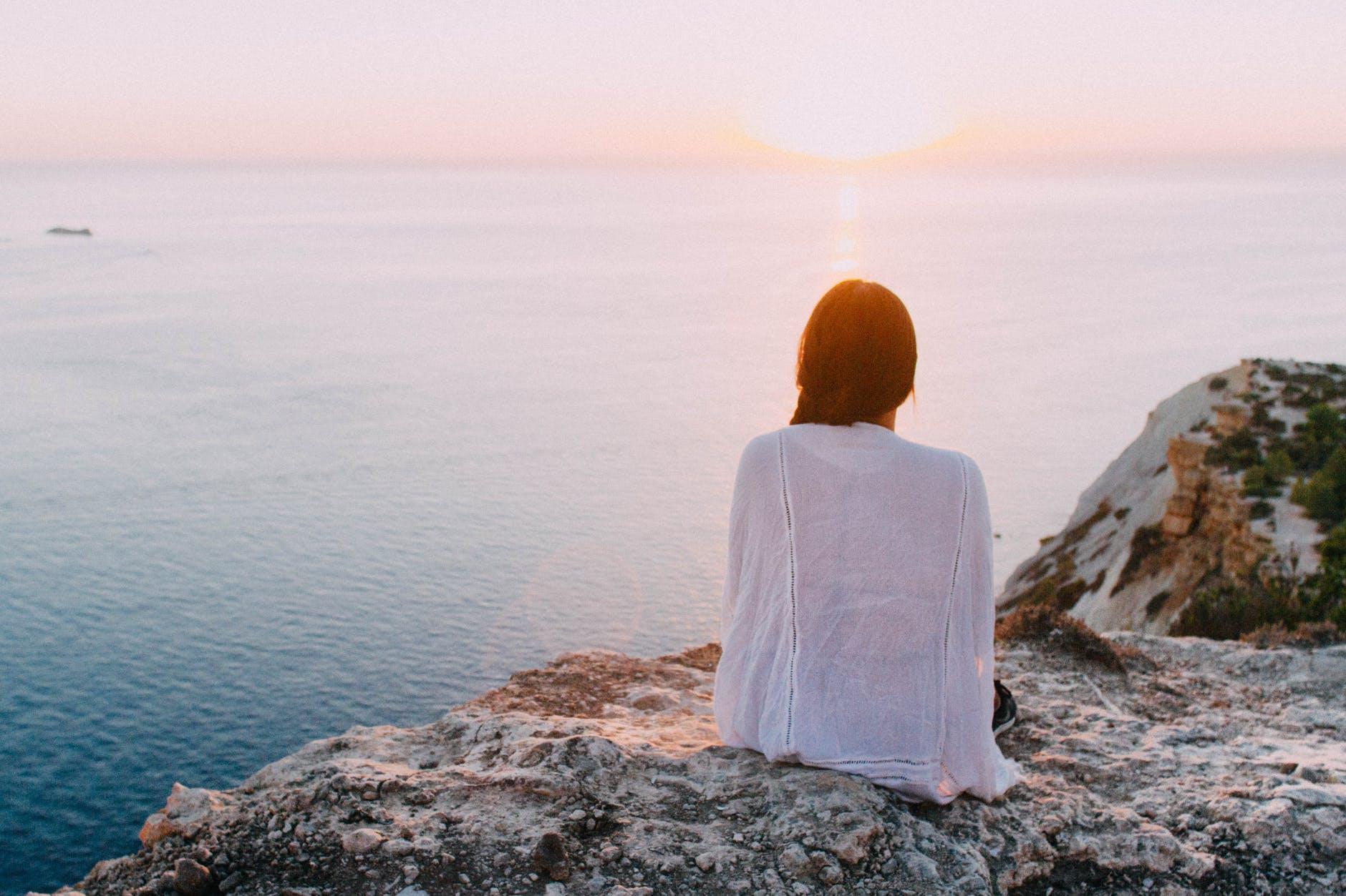 women viewing sunset cliff