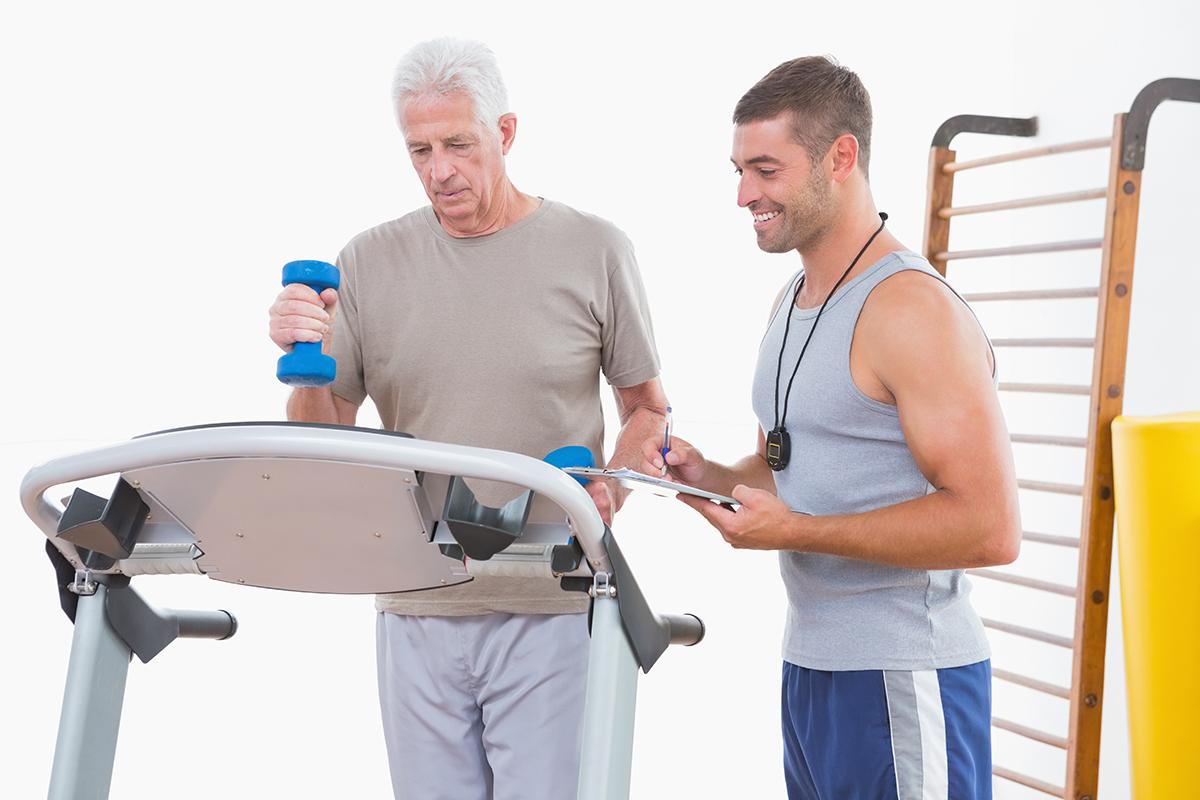 senior-man-and-trainer-treadmill