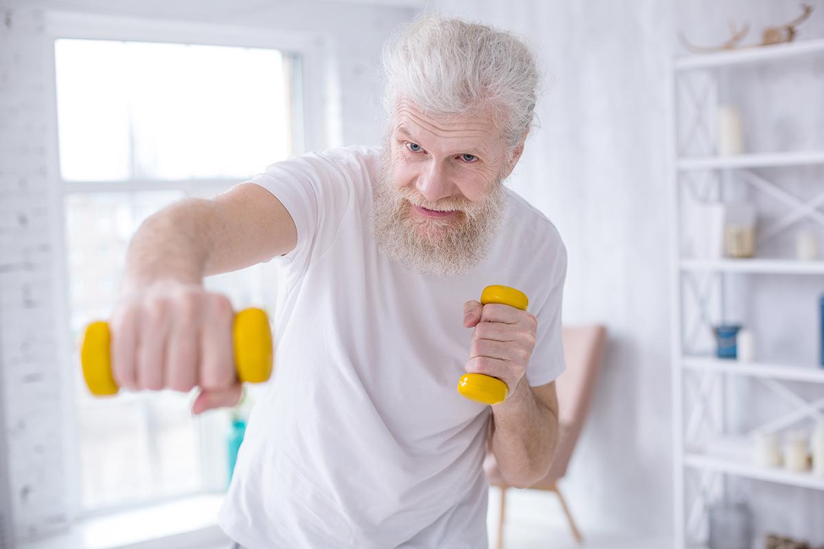 senior-man-dumbell-punch