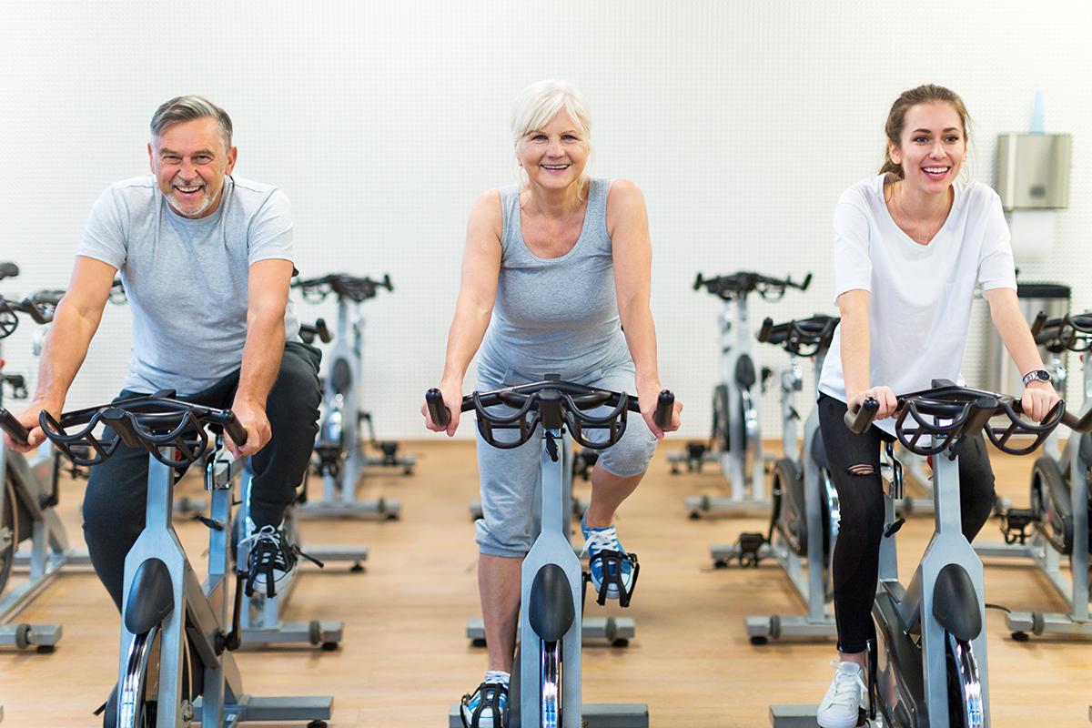 seniors-biking-in-gym-group