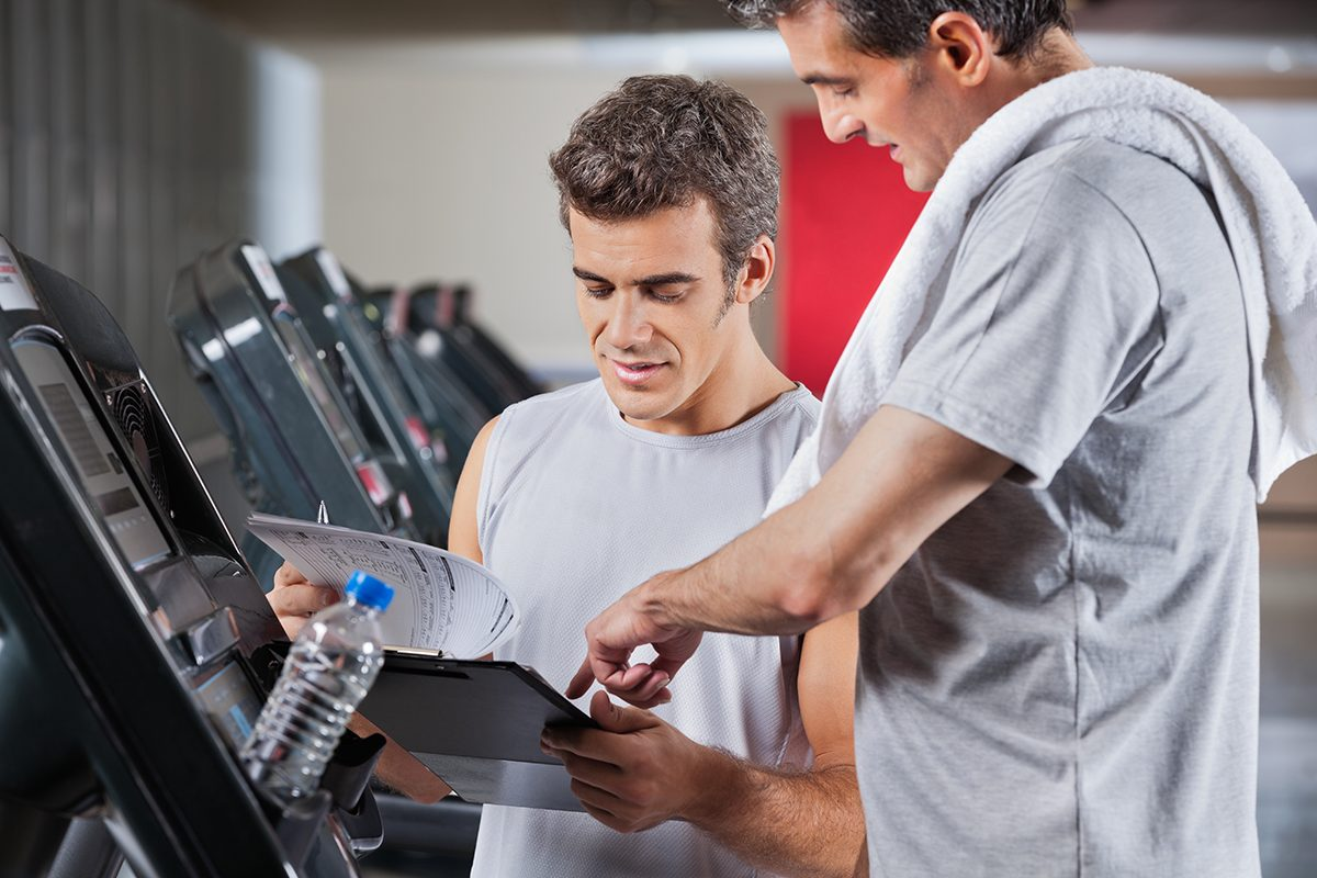 male-trainer-and-client-on-treadmill